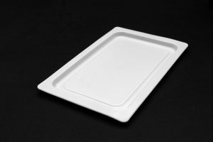 Large, hard, rectangular plastic tray