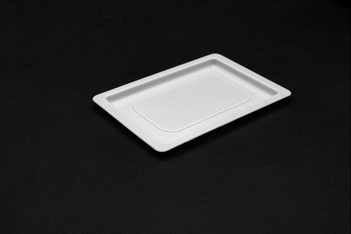 Small, hard, rectangular plastic tray